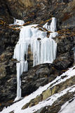 Icicle on the rock in Alps mountains Stock Images