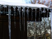 Icicle on the roof Stock Photos