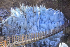 Icicle and suspension bridge Stock Photo