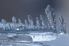 Icicle texture closeup. Frozen ice transparent abstract shape object on cold blue winter background. Soft focus photo Stock Photo