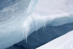 Icicles. Ice hanging from an edge of an iceberg Royalty Free Stock Images