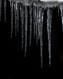 Icicles. With a black background