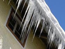 Icicles. Long, pointy icicles hanging from a roof Stock Photo
