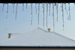 Icicles. Hanging from the roof Stock Photos