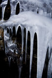 Icicles. Some icicles dripping on a stone Royalty Free Stock Photography