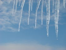 Icicles. Winter icicles hanging from my roof Stock Photos
