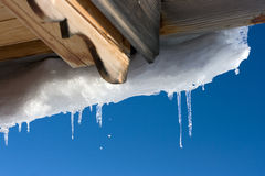 Icicles. Wooden roof and icicles. Winter Royalty Free Stock Photo