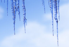 Icicles against the Winter Sky Royalty Free Stock Images