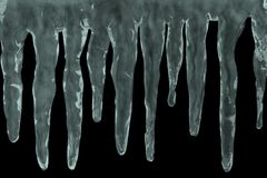 Icicles on black Royalty Free Stock Image
