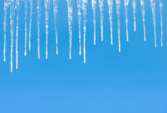 Icicles on a blue Royalty Free Stock Photos