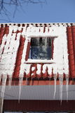 Icicles on building roof at winter day Stock Image