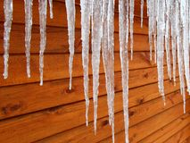 Icicles on a Cabin. Icicles hang from a wood cabin in on a chilly winter day in northern America Stock Images