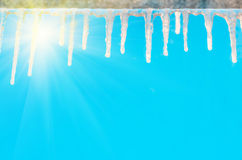 Icicles on the cornice against the blue sky Royalty Free Stock Photography