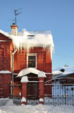 Icicles on the cottage. Icicles on the roof of the cottage. Winter royalty free stock image