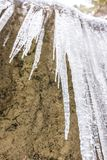 Icicles crystal on the frozen stone. Outdoor and winter stock photography