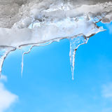 Icicles dangle from the eaves Stock Photo