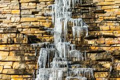 Icicles Dripping down the side of a Rock Wall royalty free stock photography
