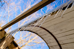 Icicles in early spring. Early spring icicles hanging from the eaves and melt Royalty Free Stock Images