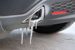 Icicles on an exhaust pipe. Stock Photos