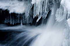 Icicles and fast water Royalty Free Stock Images