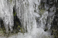 Icicles Formation on Side Of Mountain Rocks Stock Photos