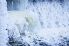 Icicles formation in waterfall Royalty Free Stock Image