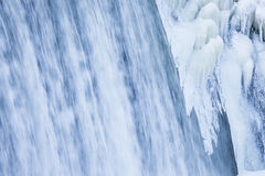 Icicles formation in waterfall Stock Images
