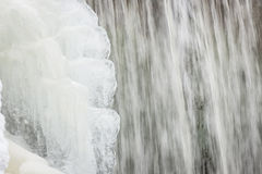 Icicles formation in waterfall Stock Photo