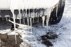 Icicles freeing on car Stock Photography