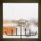 Icicles on a frosted window decorated with LED lights. Weather after the freezing rain Stock Image