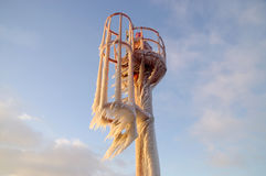 Icicles on frozen harbor light Royalty Free Stock Photo