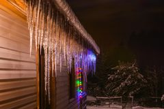Icicles grow slowly in the cold winter stock photos