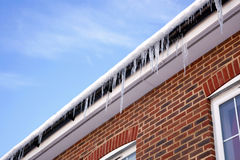 Icicles on the gutter Royalty Free Stock Photo