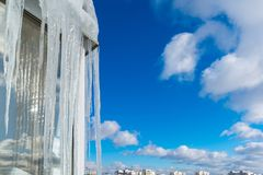 Icicles hang on balcony of house Stock Image