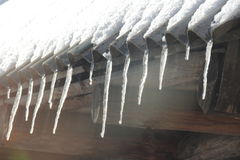 Icicles hang on the roof Royalty Free Stock Photo