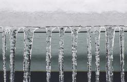 Icicles Hanging. Icicles forming and hanging from roof royalty free stock photos