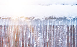 Icicles hanging against a background of wall Stock Image
