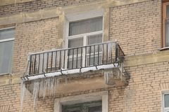 Icicles hanging from the balcony royalty free stock image