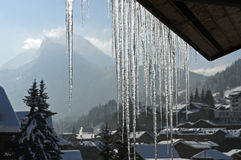 Icicles hanging down from a roof Stock Image
