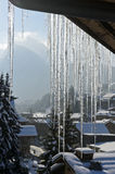 Icicles hanging down from a roof Royalty Free Stock Photography