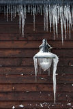 Icicles hanging from a lamp and drainpipe Stock Photography