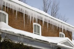 Icicles Hanging Off Rain Gutters Royalty Free Stock Photo