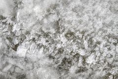 Cracked ice cover in creek royalty free stock images