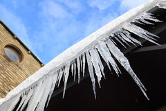 Icicles hanging from a porch Stock Image
