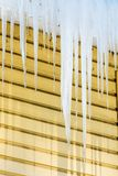 The icicles hanging from the rim of the roof royalty free stock image