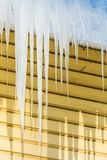 The icicles hanging from the rim of the roof stock images
