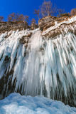 Icicles hanging from rock by the Pericnik waterfall Royalty Free Stock Images