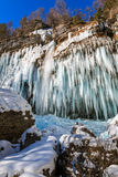 Icicles hanging from rock by the Pericnik waterfall Royalty Free Stock Image