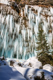 Icicles hanging from rock by the Pericnik waterfall Stock Photography