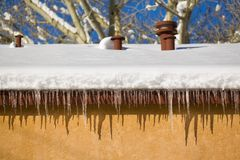 Icicles Hanging From A Roof Stock Images